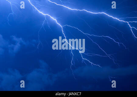 Blue lightning strike electrical storm after sundown in Florida - Stock Photo