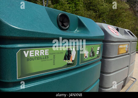 Large coloured recycling bins for glass paper and packaging - Stock Photo