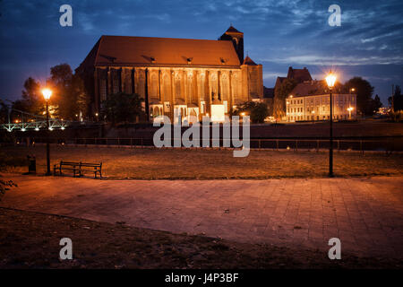 City of Wroclaw in Poland, Church of Our Lady on the Sand by night, 14th century Gothic architecture, alley in Ostrow - Stock Photo