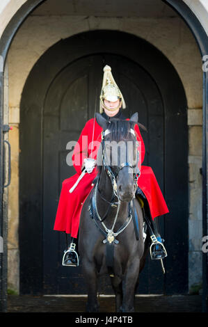 LONDON - OCTOBER 31, 2016: Mounted Queen's Life Guard of the Household Cavalry stands in an archway at St James's - Stock Photo