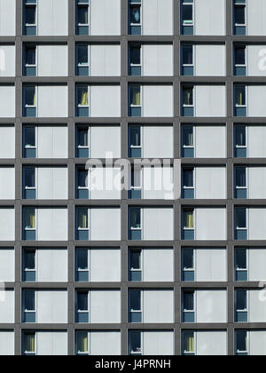 modern concrete housing development with repeating pattern windows - Stock Photo