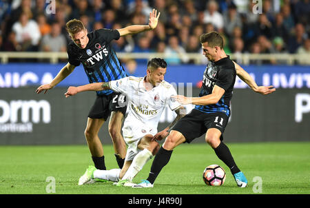 Bergamo, Italy. 13th May, 2017. Atalanta's Andrea Conti (L) and Remo Freuler (R) compete with AC Milan's Gianluca - Stock Photo