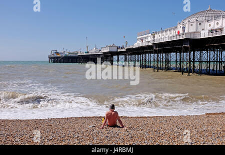 Brighton UK 14th May 2017  - A swimmer surveys the sea by Brighton Palace Pier on a beautiful sunny day with temperatures - Stock Photo