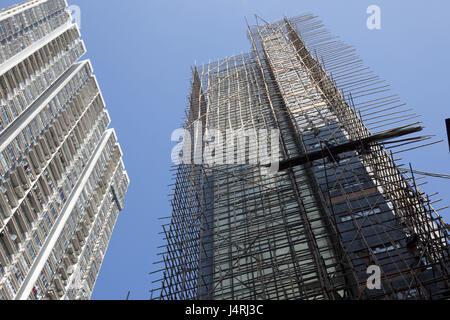 China, Hong Kong, high rise, bamboo scaffolding, - Stock Photo