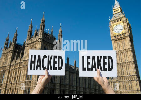 Signs representing issues with modern elections, the hacking of accounts and leaking of information, at the Houses - Stock Photo