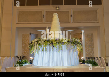 Decorated wedding cake in luxury ballroom - Stock Photo