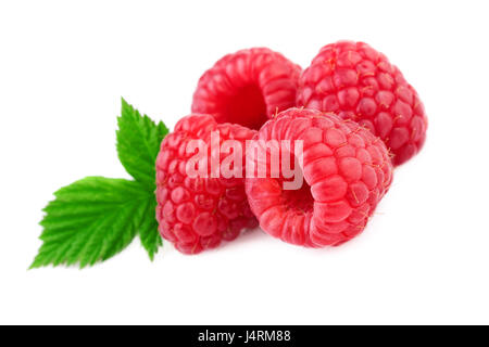 Isolated raspberries. Fresh raspberry with leaf isolated on white background - Stock Photo