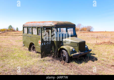 Samara, Russia - April 30, 2017: Army green abandoned retro bus in nature - Stock Photo