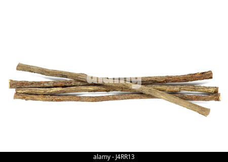 dried sticks of liquorice root isolated on white background - Stock Photo
