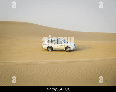 desert safari, dune bashing in a 4 wheel drive - Stock Photo