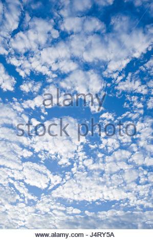 Puffy white clouds on a blue sky, Redondo Beach, Los Angeles, California, USA - Stock Photo