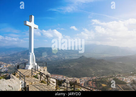 A white cross over Jaen town at the mountain, a symbol of the town with Sierra Magina mountains on background on - Stock Photo