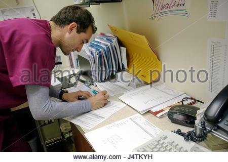 Miami Beach Florida Mt. Mount Sinai Medical Center hospital doctor's office EKG technician medical records career - Stock Photo