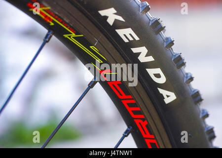 Tambov, Russian Federation - May 07, 2017 Kenda tire on bicycle wheel. - Stock Photo