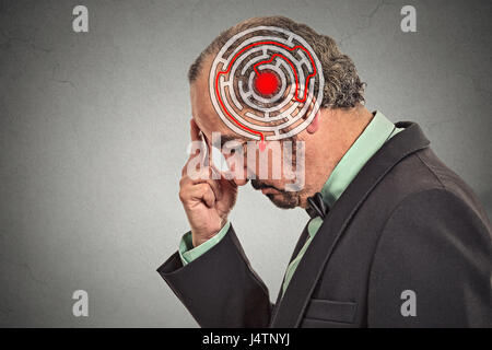 Right decision wisdom strategy concept. Side profile middle aged man solving problem isolated on gray wall background. - Stock Photo