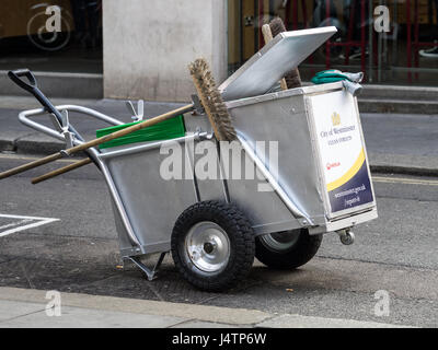 A street Cleaning cart belonging to Westminster council in central London - Stock Photo