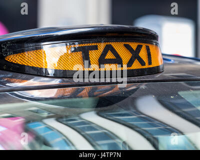 London Taxi Black Cab - Illuminated signs on the roof of London Taxis (Black Cabs) signal their availability for - Stock Photo