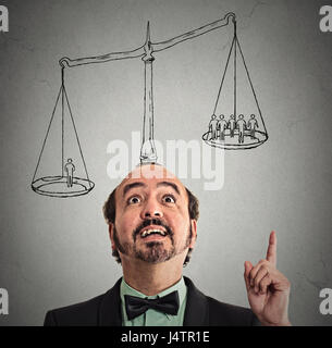 businessman with scale above head has idea solution one man weighting more than group off business people on balance. - Stock Photo