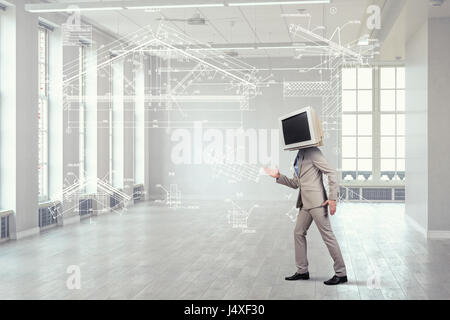 Businessman with old computer monitor instead of his head. Mixed media - Stock Photo