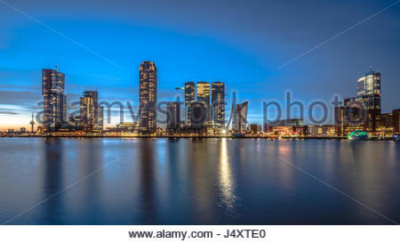 Rotterdam Skyline at dusk within the Rhine–Meuse–Scheldt river delta at the North Sea - Stock Photo