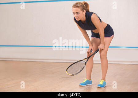 Young woman squash player exercise game in the gym - Stock Photo