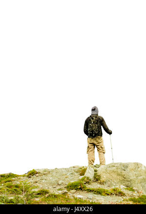 Isolated photo of man at top of mountains holding walking stick watching the view - Stock Photo