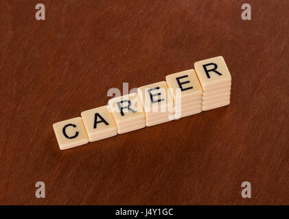 Chart with words Career. Career stair concept. Ivory tiles with capital letters on mahogany board. - Stock Photo