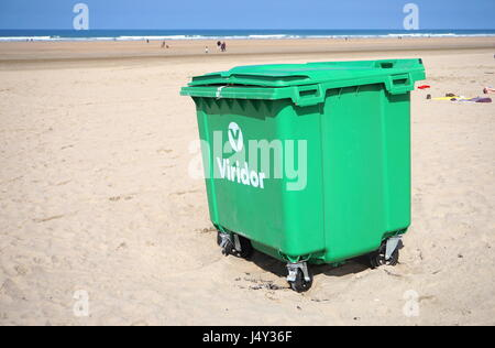 Cornwall, England, UK - April 7th 2017: Large wheeled waste, rubbish or garbage wheelie bin on Newquay beach in - Stock Photo