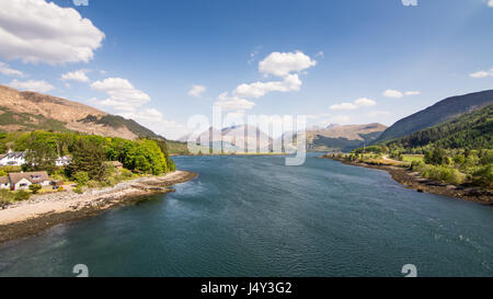 Looking down Loch Leven sea inlet from the Ballachulish Bridge in the West Highlands of Scotland. - Stock Photo