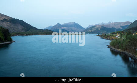 The Pap of Glencoe and other mountains surround Loch Leven sea loch at Ballachulish in the West Highlands of Scotland. - Stock Photo