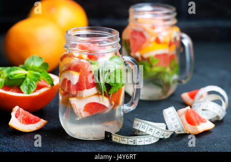 detox drink with grapefruit in glass bank - Stock Photo