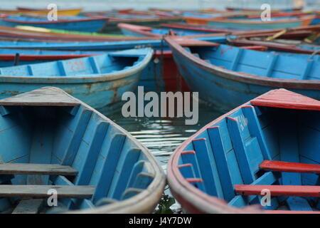 Colourful boats on Phewa Lake in Pokhara, Nepal - Stock Photo