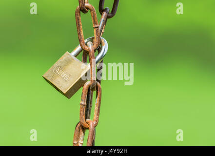 Locked concept. Locked padlock around a rusty chain. Lock hanging from a chain. - Stock Photo