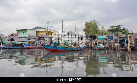 Traditional wooden fishing boats and runabouts in the Sunda Kelapa inner harbour, Jakarta, Indonesia - Stock Photo