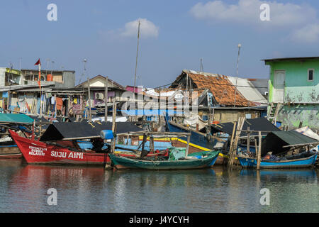 Traditional fishing boats and runabouts, Sunda Kelapa Harbour, Jakarta, Indonesia - Stock Photo