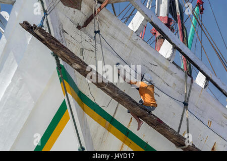 Endless job of sanding and painting a wooden pinisi, Sunda Kelapa Harbour, Jakarta, Indonesia - Stock Photo
