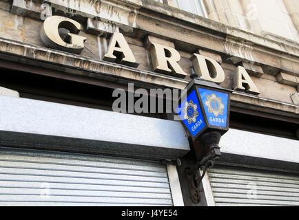 Garda police sign and blue lamp, city of Dublin, Ireland, Irish Republic - Stock Photo
