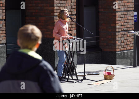 LONDON, UK - APRIL 22, 2017: Shoreditch, London: street musicians at Columbia Road flower market . Street artists - Stock Photo