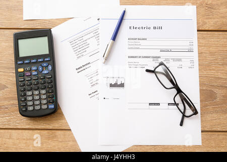 Electricity bill charges paper form on the table - Stock Photo