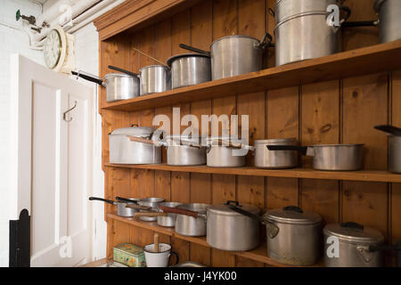 Collection of vintage saucepans on wooden kitch dresser - Stock Photo