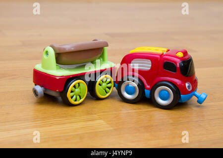 Small toy car with a trailer - Stock Photo