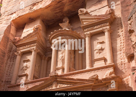 Close up of the Treasury, an ancient building in Petra, Jordan. Orange stone with columns carved by Nabataens is - Stock Photo