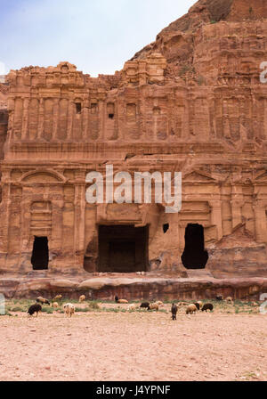 The ornately carved sandstone facade surrounding the entrance of the Corinthian Tomb in Petra or Raqmu, Jordan. - Stock Photo