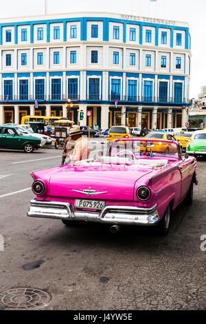 Ford Fairlane automobile model in Cuba Cuban car in Havana pink  Ford Fairlane cabriolet in front of Hotel Telegrafo - Stock Photo