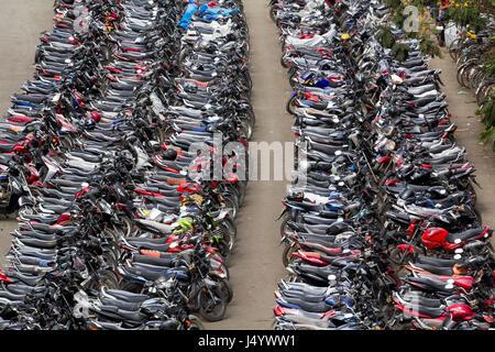 Motor bikes parked, mira road railway station, thane, maharashtra, india, asia - Stock Photo