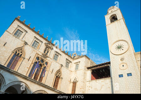 Classic clock tower, built in 1444, standing next to the Sveti Vlaho (Saint Blaise) Church on the Stradun in Old - Stock Photo