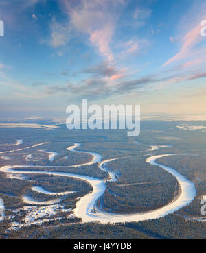 Small farm on the bank taiga river, top view - Stock Photo