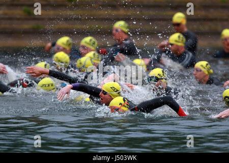 Peterborough, Cambridgeshire, UK. 13th May, 2017. Competitors in the Monster Mojito Triathlon start the race swimming - Stock Photo