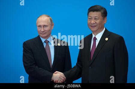 Beijing, China. 15th May, 2017. Chinese President Xi Jinping, right, and Russian President Vladimir Putin shake - Stock Photo