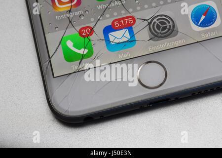 Display broken: broken glass on a smartphone, iPhone 6 Plus. - Stock Photo